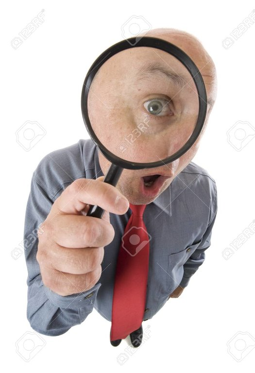 104362793-a-person-using-a-magnifying-glass-to-look-closer-magnifying-own-eye-.jpg