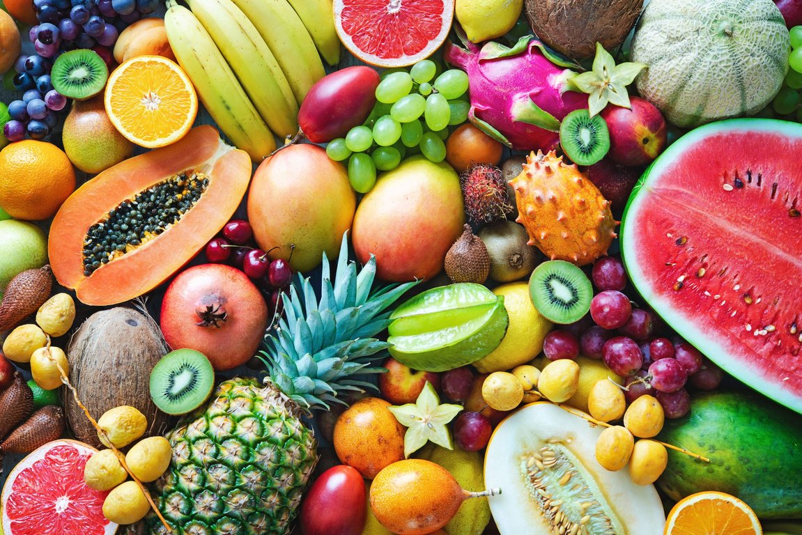 assortment-of-colorful-ripe-tropical-fruits-top-royalty-free-image-995518546-1564092355.jpg