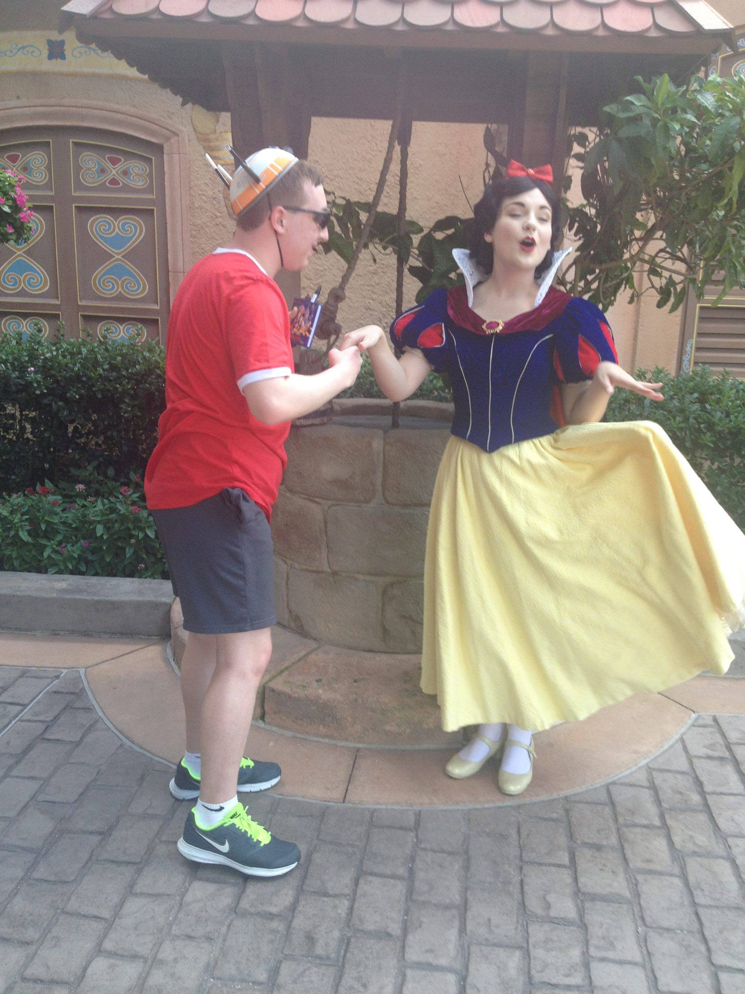 Kissing Snow White's hand